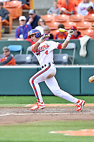 Clemson Tigers shortstop Eli White (4) swings at a pitch during a game against the Notre Dame Fighting Irish during game one of a double headers at Doug Kingsmore Stadium March 14, 2015 in Clemson, South Carolina. The Tigers defeated the Fighting Irish 6-1. (Tony Farlow/Four Seam Images)