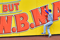 3 September 2012: Chicago Cubs outfielder Joe Mather makes a catch up against the wall during game action against the Washington Nationals at Nationals Park in Washington, DC. The Nationals edged out the visiting Cubs 2-1, in the first game of heir 4-game series. Mandatory Credit: Ed Wolfstein Photo