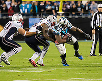 The Carolina Panthers play the New England Patriots at Bank of America Stadium in Charlotte North Carolina on Monday Night Football.  The Panthers defeated the Patriots 24-20.  Carolina Panthers fullback Mike Tolbert (35) is tackled by New England Patriots middle linebacker Brandon Spikes (55), New England Patriots defensive end Rob Ninkovich (50)