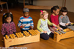 Education elementary school Grade 1 school for musically gifted children group playing note patterns