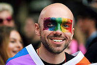 A man with a rainbow painted across his face joins thousands of people in this year's Pride Parade in the centre of Cardiff, Wales, UK. Sayurday 26 August 2017