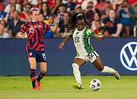 AUSTIN, TX - JUNE 16: Michelle Alozie #22 of Nigeria crosses the ball during a game between Nigeria and USWNT at Q2 Stadium on June 16, 2021 in Austin, Texas.