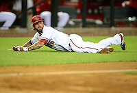 Apr. 17, 2012; Phoenix, AZ, USA; Arizona Diamondbacks outfielder Ryan Roberts dives for a catch during game against the Pittsburgh Pirates at Chase Field.Mandatory Credit: Mark J. Rebilas-.