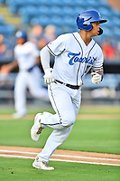 Asheville Tourists  second baseman JC Correa (11) runs to first base during a game against the Hickory Crawdads on July 21, 2021 at McCormick Field in Asheville, NC. (Tony Farlow/Four Seam Images)