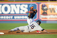 Reading Fightin Phils shortstop Edgar Duran (16) turns a double play as Bryan LaHair (16) of the Akron Rubber Ducks slides into second base at FirstEnergy Stadium on June 19, 2014 in Wappingers Falls, New York.  The Rubber Ducks defeated the Fightin Phils 3-2.  (Brian Westerholt/Four Seam Images)