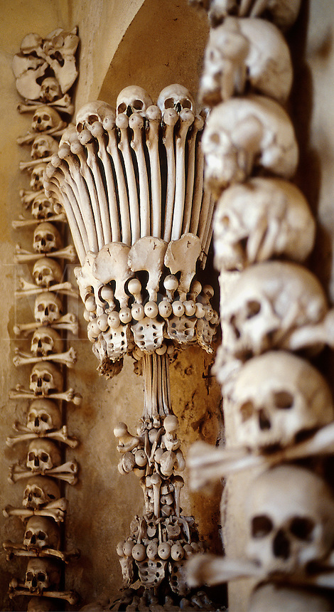 Detail view of skull and bones used as decoration in the Chapel of All Saints Cemetery. The bone motifs were created from skeletons that had accumulated since the 14th century. Kutna Hora, Bohemia, Czech Republic.