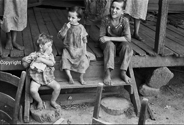 1935-File Photo -<br /> <br /> Poor Sharecropper, family in Hale County, Alabama