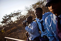 Students from grades 8 and 9 at Kafinda basic school in Sereje district, on their first safari in Kasanka National Park. Local schools and women's groups are regularly brought into Kasanka, which is unique in the country and unusual in Africa as it is privately managed and owned by a trust. People are able to see animals flourishing in land which was once free reign for poachers. Combined with anti-poaching scouts, the education programme is on the frontline of conservation methods in the park, showing local people wild animals in their natural habitat.