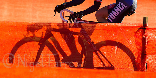03 NOV 2012 - IPSWICH, GBR - Christel Ferrier Bruneau (FRA) of France makes her way through a zig-zag section of the course marked with orange scrim during the Elite Women's European Cyclo-Cross Championships in Chantry Park, Ipswich, Suffolk, Great Britain (PHOTO (C) 2012 NIGEL FARROW)