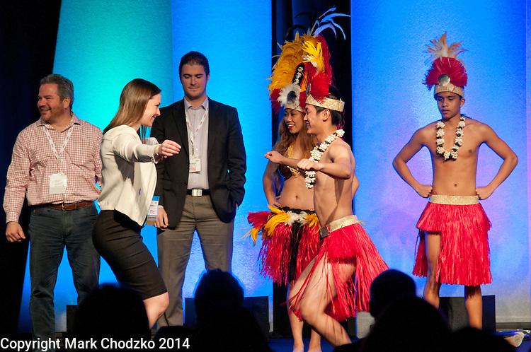 Sales Rep dances with Hawaiian dancer at 2014 National Sales Meeting