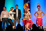 Sales Rep dances with Hawaiian dancer at 2014 National Sales Meeting