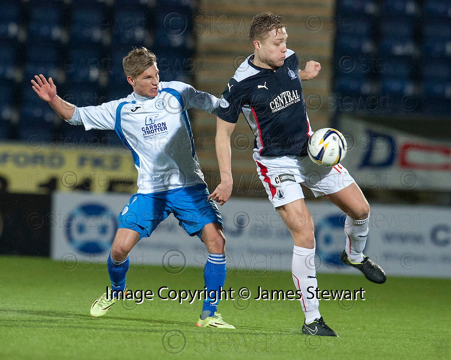 Falkirk's Peter Grant gets away from Queen of the South's Gavin Reilly.