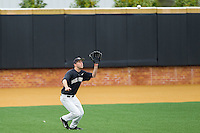 Wake Forest Demon Deacons left fielder Grant Shambley (43) tracks a fly ball against the Florida State Seminoles at Wake Forest Baseball Park on April 19, 2014 in Winston-Salem, North Carolina.  The Seminoles defeated the Demon Deacons 4-3 in 13 innings.  (Brian Westerholt/Four Seam Images)