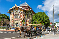Fort-de-France, Martinique.  Tourists in Carriage  Passing the Victor Schoelcher Library Museum, Romanesque Architectural Style.
