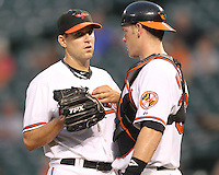 Matt Weiters #32 of the Baltimore Orioles talks to pitcher Brad Bergensen #35 during a MLB game against the Seattle Mariners at Camden Yards, on August 8 2010, in Baltimore, Maryland. Orioles won 5-4 in extra innings.