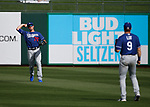 DJ Peters throws to Gavin Lux during a spring training game between the Texas Rangers and Los Angeles Dodgers in Surprise, Ariz., on Sunday, March 7, 2021.<br /> Photo by Cathleen Allison