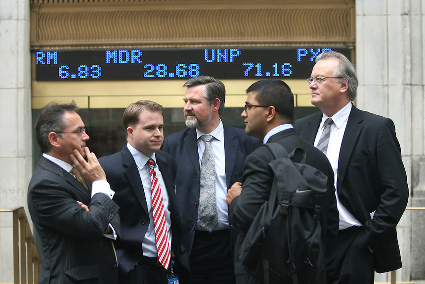 """NEW YORK CITY - September 16, 2008: A reflective mood is seen in group which emerged from the New York Stock Exchange  One trader said that """"volume is low and morale is low"""".  Wall St.  Newsday/Ari Mintz  9/16/2008."""