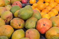 Senegal, Saint Louis.  Mangoes and Oranges at a Street-side Vendor.