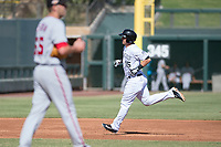 Salt River Rafters first baseman Brian Mundell (15), of the Colorado Rockies organization, rounds the bases after hitting a home run off Kyle McGowin (55) during an Arizona Fall League game against the Mesa Solar Sox on October 30, 2017 at Salt River Fields at Talking Stick in Scottsdale, Arizona. The Solar Sox defeated the Rafters 8-4. (Zachary Lucy/Four Seam Images)