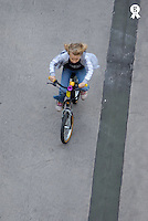 Girl (5-7) riding bicycle on pavement, elevated view (Licence this image exclusively with Getty: http://www.gettyimages.com/detail/73532501 )
