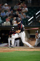 Rochester Red Wings center fielder Jeremy Hazelbaker (21) follows through on a swing during a game against the Lehigh Valley IronPigs on September 1, 2018 at Frontier Field in Rochester, New York.  Lehigh Valley defeated Rochester 2-1.  (Mike Janes/Four Seam Images)