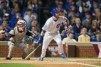 Chicago Cubs Ben Zobrist (18) hits a single in front of catcher Roberto Perez (55) in the second inning during Game 3 of the Major League Baseball World Series against the Cleveland Indians on October 28, 2016 at Wrigley Field in Chicago, Illinois.  (Mike Janes/Four Seam Images)