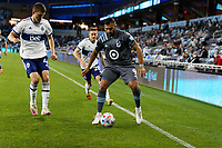 SAINT PAUL, MN - MAY 12: Ramon Abila #9 of Minnesota United FC with the ball during a game between Vancouver Whitecaps and Minnesota United FC at Allianz Field on May 12, 2021 in Saint Paul, Minnesota.