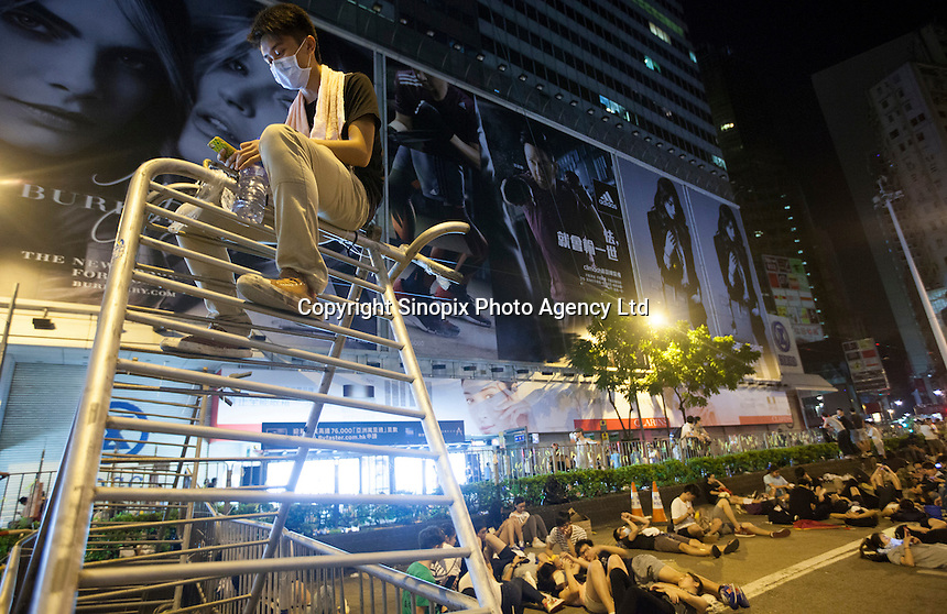 Protesters are seen blocking Causeway Bay on first day of Occupy Hong Kong, Hong Kong, China, 29 September 2014. Several areas of the city including Central, Admiralty, Causeway Bay, as well as Mong Kok in Kowloon, were locked down by Occupy Central civil disobedience teams who fanned out across the city blocking major thoroughfares as well as side streets, with rip ties, metal barriers, police road cones and any other street furniture available to hand.