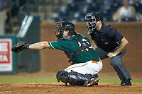 Greensboro Grasshoppers catcher J.D. Osborne (46) reaches for a pitch as home plate umpire Thomas Fornarola looks on during the game against the West Virginia Power at First National Bank Field on August 9, 2018 in Greensboro, North Carolina. The Power defeated the Grasshoppers 9-7 in game two of a double-header. (Brian Westerholt/Four Seam Images)