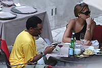 SPIKE LEE & TONYA LEWIS LEE.The Film Award Sesterzio Silver 2008 held at the Jardin de Russie,.Rome 24th June 2008..half length wife married husband wife yellow t-shirt table sitting food drink wine sunglasses phone.CAP/CAV.©Luca Cavallari/Capital Pictures