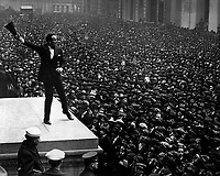 Douglas Fairbanks, movie star, speaking in front of the Sub-Treasury building, New York City, to aid the third Liberty Loan.   April 1918.  Paul Thompson.  (Army)<br /> Exact Date Shot Unknown<br /> NARA FILE #:  111-SC-16569<br /> WAR & CONFLICT BOOK #:  515