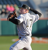 Pitcher Tanner Hawley (17) of the Wofford Terriers pitches in the fifth inning of a game against the Clemson Tigers on Wednesday, March 6, 2013, at Doug Kingsmore Stadium in Clemson, South Carolina. Clemson won, 9-2. (Tom Priddy/Four Seam Images)