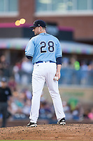 Durham Bulls relief pitcher Neil Wagner (28) looks to his catcher for the sign against the Buffalo Bisons at Durham Bulls Athletic Park on April 30, 2017 in Durham, North Carolina.  The Bisons defeated the Bulls 6-1.  (Brian Westerholt/Four Seam Images)
