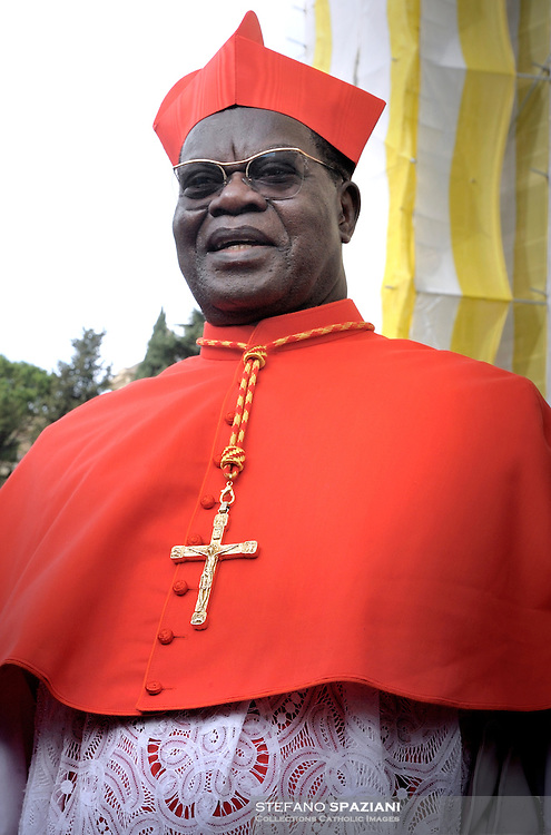cardinal ring to DR Congo Laurent Monsengwo Pasinya (R) during the Eucharistic celebration with the new cardinals on November 21, 2010 at St Peter's basilica at The Vatican. 24 Roman Catholic prelates joined the day before the Vatican's College of Cardinals, the elite body that advises the pontiff and elects his successor upon his death