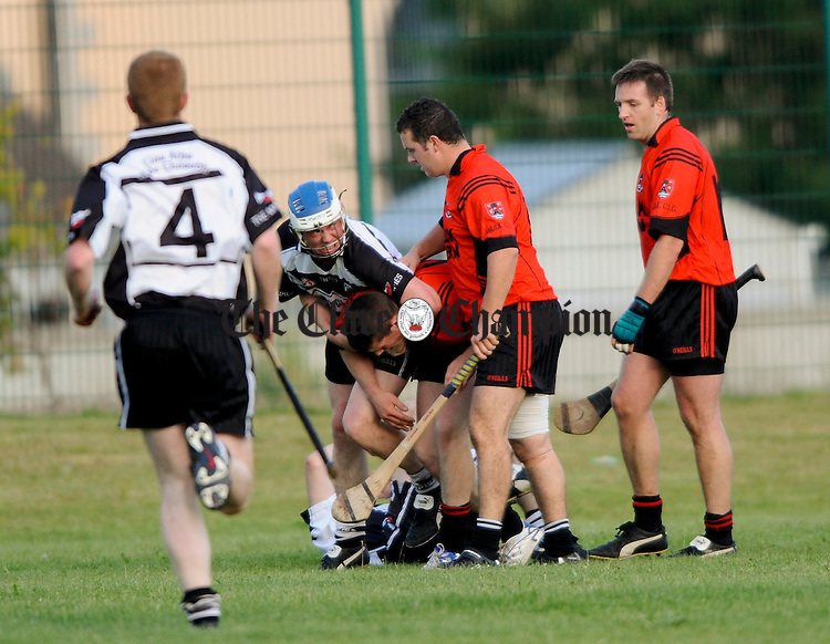 Kieran Lynch of Clarecastle goes down after taking  the force of a Meelick hurley during their Intermediate Championship game at Clarecastle. Photograph by John Kelly.