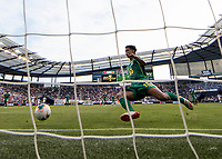 KANSAS CITY, KS - JUNE 26: Terence Vancooten #15 tries unsuccessfully to prevent a goal during a game between Guyana and Trinidad