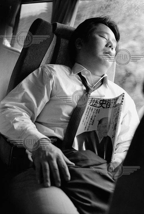 Man sleeping on a long-distance coach.