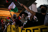 NEW YORK, NY - JUNE 15: A pro-Palestinian group wave flags next to Grand Central Terminal during a large protest in New York on June 15, 2021. The solidarity action of hundreds of pro-Palestinians is a form of support against attacks carried out by the Israeli government. At the same time, Palestinian Prime Minister Mohammad Shtayyeh says the new Israeli government is just as bad as the old one and condemns Naftali Bennett's announcements in support of Israeli settlements. That is why the demonstrations continue in different parts of the world. (Photo by Pablo Monsalve / VIEWpress via Getty Images