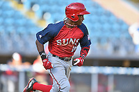 Hagerstown Suns center fielder Victor Robles (16) runs to first during a game against the Asheville Tourists at McCormick Field on April 28, 2016 in Asheville, North Carolina. The Tourists were leading the Suns 6-5 when the game was delayed in the top of the 6th inning due to darkness. (Tony Farlow/Four Seam Images)