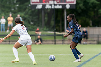 NEWTON, MA - AUGUST 29: Jada Konte #7 of University of Connecticut looks to pass during a game between University of Connecticut and Boston College at Newton Campus Soccer Field on August 29, 2021 in Newton, Massachusetts.
