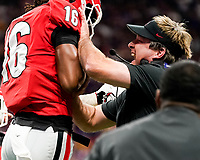 ATLANTA, GA - DECEMBER 7: Lewis Cine #16 of the Georgia Bulldogs celebrates his presumed fumble recovery with head coach Kirby Smart of the Georgia Bulldogs during a game between Georgia Bulldogs and LSU Tigers at Mercedes Benz Stadium on December 7, 2019 in Atlanta, Georgia.