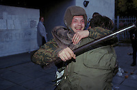 Moscow, Russia, 03/10/1993..Anti-Government fighters celebrate after breaking through the police barricades surrounding the Russian Parliament. When President Boris Yeltsin dissolved the opposition-dominated Russian Parliament,  deputies and supporters, led by Vice President Alexander Rutskoi, barricaded themselves inside the White House. After a 10 day stand-off the situation exploded into violence between pro and anti Yeltsin forces.