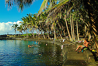 Ahalanui hot pond - Pahoa, Big island of Hawaii. The water is brackish but very clear and fish often swim along with visitors