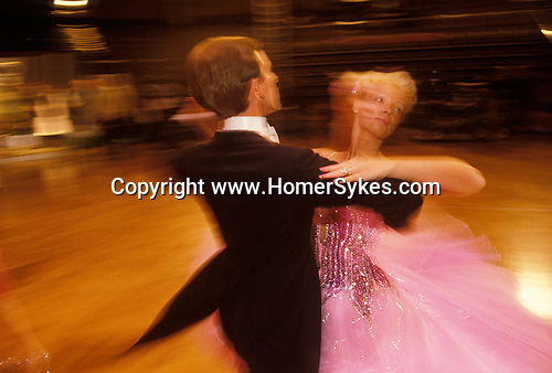 Blackpool, Lancashire. 1980's   <br /> Contestants quickstep around the dance floor, they are practicing for Come Dancing a British ballroom dancing competition at The Winter Gardens, Empress Ballroom.
