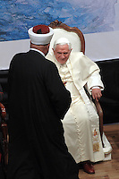 Pope Benedict XVI,shakes hands with Sheikh Taysir Tamimi during an interfaith gathering at the Notre Dame Center in Jerusalem, Monday, May 11, 2009