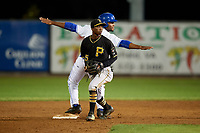 Bristol Pirates shortstop Victor Ngoepe (5) looks to the umpire to make a call while D.J. Daniels (6) signals that he thinks he's safe during a game against the Bluefield Blue Jays on July 26, 2018 at Bowen Field in Bluefield, Virginia.  Bristol defeated Bluefield 7-6.  (Mike Janes/Four Seam Images)