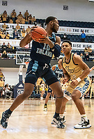 WASHINGTON, DC - FEBRUARY 8: Cyril Langevine #10 of Rhode Island pulls the ball back from Jameer Nelson Jr. #12 of George Washington during a game between Rhode Island and George Washington at Charles E Smith Center on February 8, 2020 in Washington, DC.