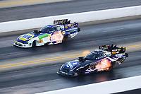 Oct 12, 2019; Concord, NC, USA; NHRA funny car driver Jack Beckman (near) alongside Ron Capps during qualifying for the Carolina Nationals at zMax Dragway. Mandatory Credit: Mark J. Rebilas-USA TODAY Sports