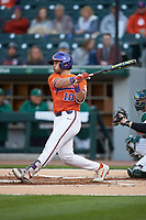 Kyle Wilkie (10) of the Clemson Tigers follows through on his swing against the Charlotte 49ers at BB&T BallPark on March 26, 2019 in Charlotte, North Carolina. The Tigers defeated the 49ers 8-5. (Brian Westerholt/Four Seam Images)
