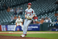 Arkansas Razorbacks relief pitcher Jacob Burton (21) reacts to an out during the game against the Texas Longhorns in game six of the 2020 Shriners Hospitals for Children College Classic at Minute Maid Park on February 28, 2020 in Houston, Texas. The Longhorns defeated the Razorbacks 8-7. (Brian Westerholt/Four Seam Images)